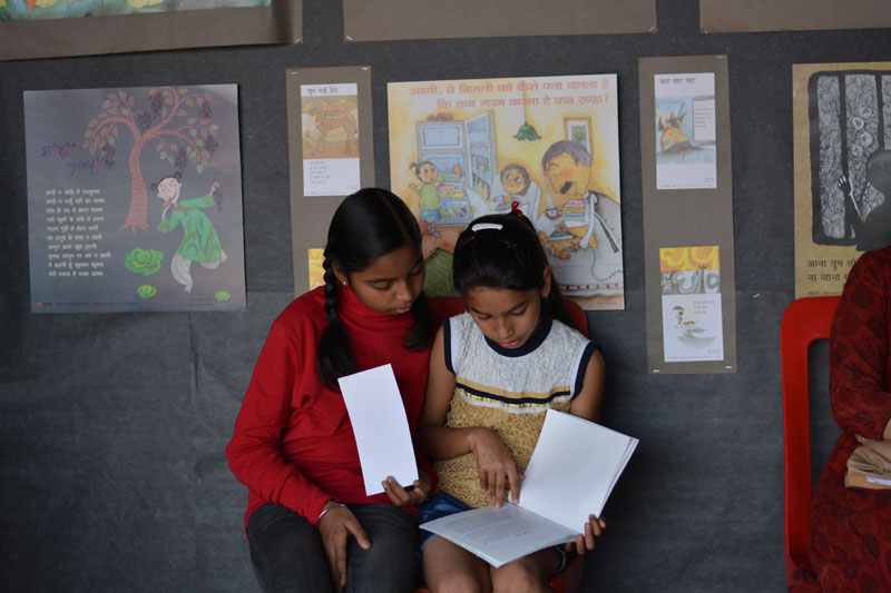 Girls reading at our stall at Lokrang